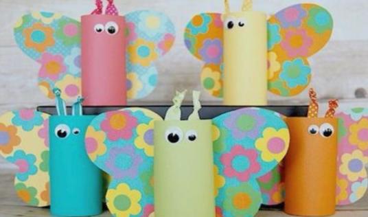 Verschillende kleuren vlinders gemaakt van wc-rollen die je samen met je oppaskindjes kan maken na school